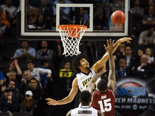 IowaÕs Dom Uhl (25) blocks a shot during their first round NCAA championship game on Friday, March 18, 2016 in New York City,New York.