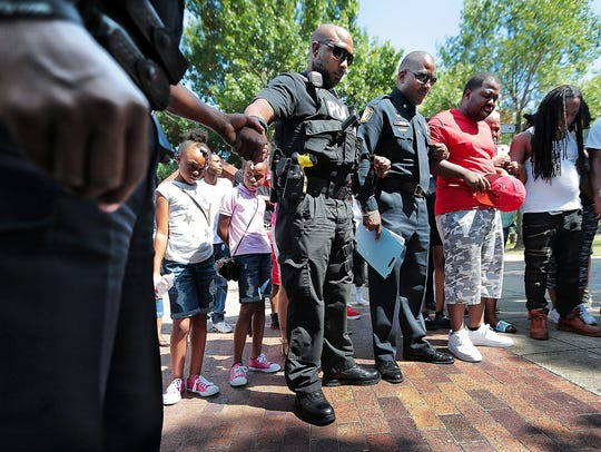 Memphis Police Officers and local activists join hands