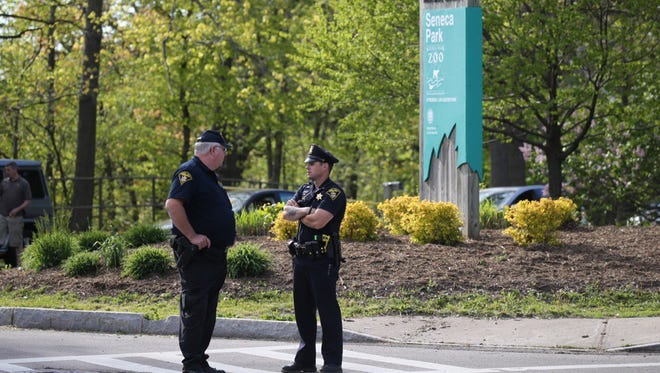 Officers stand at the entrance to the Seneca Park Zoo.