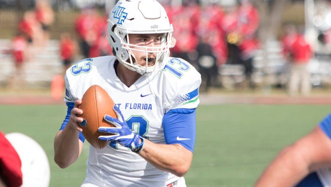 Quarterback Mike Beaudry (13) looks for an open receiver during the UWF vs West Alabama playoff football game in Livingston, Alabama on Saturday, December 2, 2017.