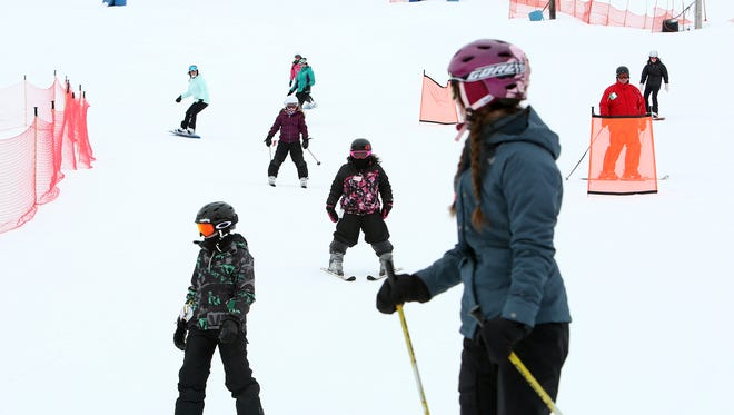 Skiers and snowboarders take to the snow at Thunder Ridge in this file photo.