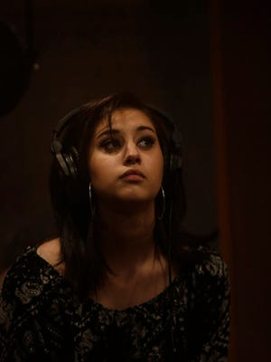 Artist Jena Irene during a recording session at Studio A in Dearborn Heights .