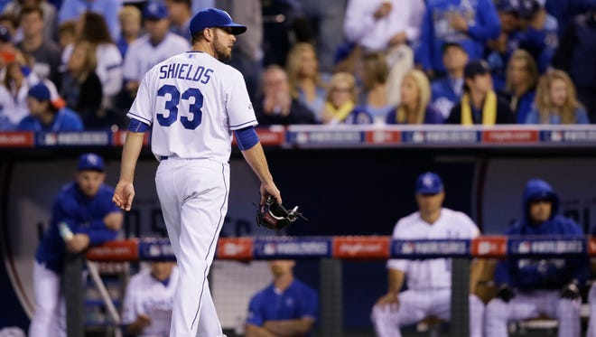 Kansas City Royals pitcher James Shields walks off the field after being relieved by Danny Duffy after giving four runs during the fourth inning of Game 1 of the World Series on Oct. 21, 2014.