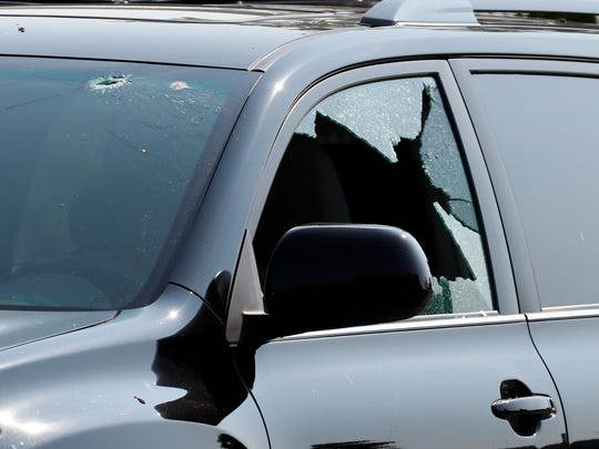 A vehicle is seen with bullet holes in it at the scene of a shooting near a baseball field in Alexandria, Va., June 14, 2017, where House Majority Whip Steve Scalise of La. was shot at a congressional baseball practice.