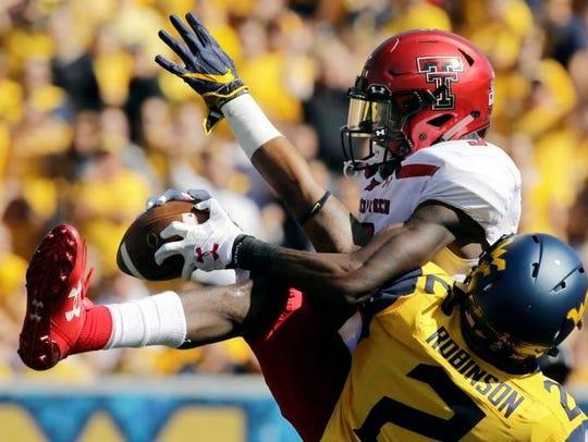 Tech wide receiver T.J. Vasher catches a 53-yard touchdown