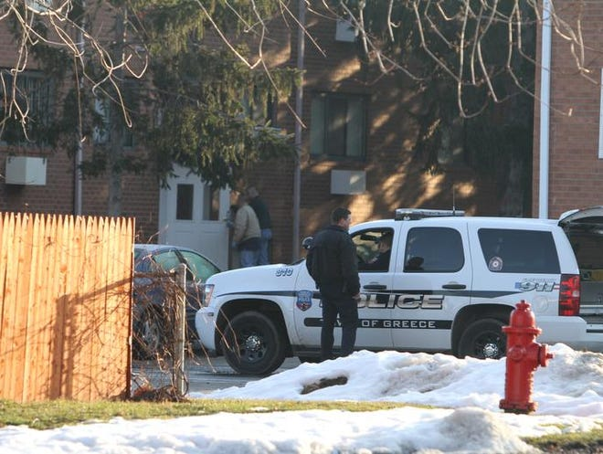Greece police investigate the triple homicide at Holyoke Park Apartments in Greece on March 10, 2010.