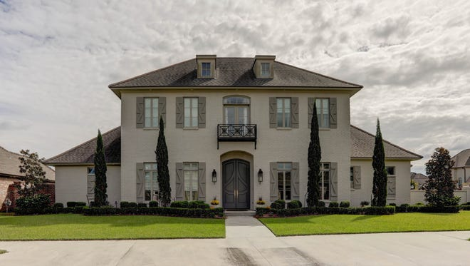 This 5 bedroom, 6 bath home is located at 107 English Gardens Parkway in Lafayette. It is listed at $1,275,000.
