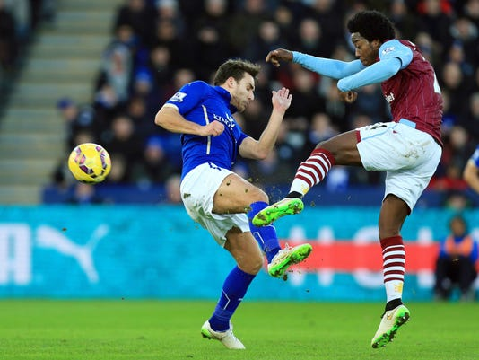 Leicester City's Matty James, left, blocks a shot from Aston Villa's Carlos Sanchez during the English Premier League soccer match at the King Power Stadium, Leicester, England, Saturday Jan. 10, 2015. (AP Photo/PA, Mike Egerton) UNITED KINGDOM OUT  NO SALES  NO ARCHIVE