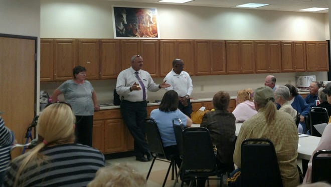 From left, Deb Cason, a volunteer, Capt. Dave Huberty, of the Des Moines Police Department, and Inspector Ted Jefferson, of the Des Moines Fire Department, answer questions from senior citizens at the first TRIAD meeting Oct. 19, 2015, at North Polk County Senior Center in Des Moines.