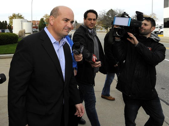 Former Rizzo Environmental Services CEO Chuck Rizzo leaves the federal court building in Port Huron last November.