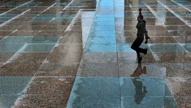 """On a rain soaked Legislative Plaza which could later turn to ice as colder temperature affect Nashville, Verner Garrett takes advantage of the slick pavement to practice some """"Memphis Jookin"""", a urban street dance that originated in Memphis on  Wednesday March 4, 2015, in Nashville in Tenn."""