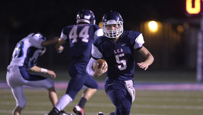 Lafayette Christian quarterback Regan Miller (5) scrambles with the football during the first half of the Kiwanis Jamboree against Westminster Christian at Teurlings Catholic High School in Lafayette, La., Thursday, Aug. 28, 2014.