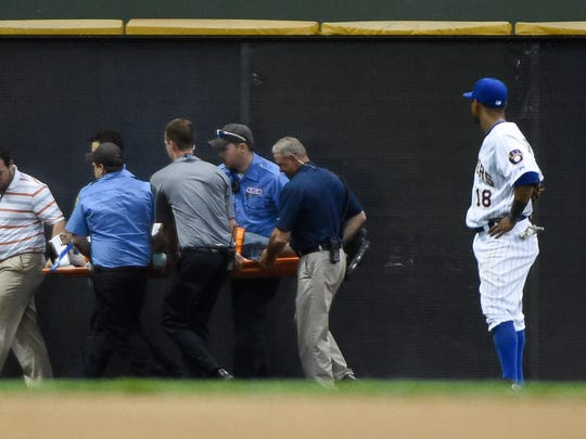 Brewers left fielder Khris Davis (18) watches medical