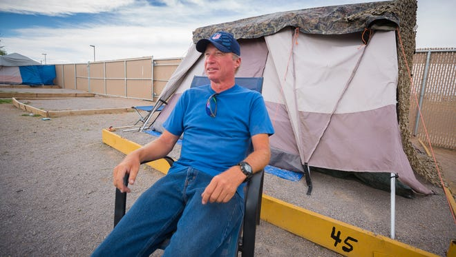 Veteran Reno Young sits outside his tent at the Mesilla Valley Community of Hope's Camp Hope tent city on June 1, 2016. After 10 months at the tent city, Young will be moving to permanent accommodation thanks to grant  funding from the state of New Mexico specifically allocated to help veterans. The state, citing budget shortfalls, has announced it will not be renewing the grant this year.