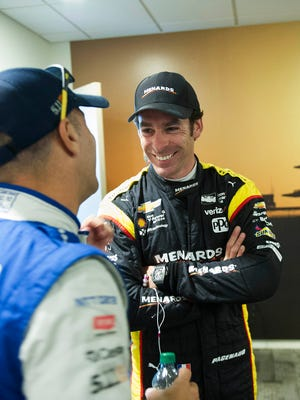 May 13, 2017; Speedway, IN, USA; Indycar drivers Tony Kanaan (left) and Simon Pagenaud talk before the Indycar Grand Prix at Indianapolis Motor Speedway Road Course.