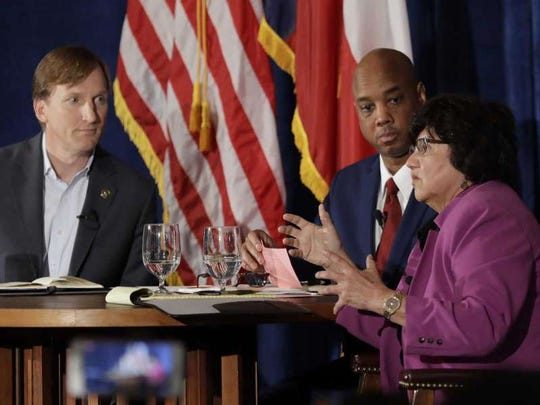 Andrew White and Lupe Valdez debate in Austin on May 11, 2018. At center, moderator Gromer Jeffers of the Dallas Morning News.