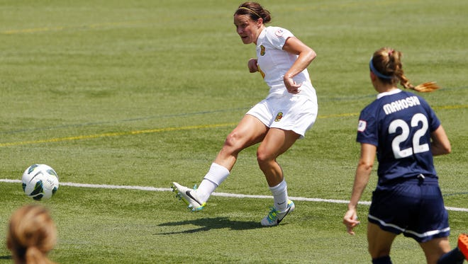 The Flash's Sarah Huffman takes a shot during a game against Sky Blue FC July 21, 2013.