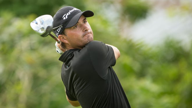 Kevin Kisner of the United States plays a tee shot at the 18th hole during continuation of the first round of the 2013 OHL Classic at Mayakoba, played at El Camaleon Golf Club  on November 15, 2013 in Playa Del Carmen, Mexico.