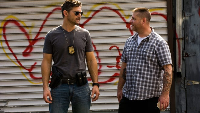 "Author and retired policeman Ralph Sarchie, right, whose story is told in the motion picture  ""Deliver Us From Evil,"" with actor Eric Bana on the set of the movie."