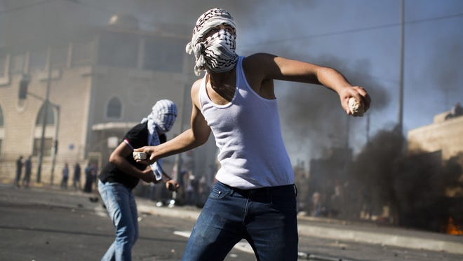 Palestinian youths clash with Israeli police near to the house of murdered Palestinian teenager Mohammed Abu Khdair, in Jerusalem on July 2.