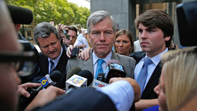 Former Virginia Gov. Bob McDonnell, center, leaves his trial Aug. 28, 2014, at U.S. District Court in Richmond, Va., with his son Bobby.