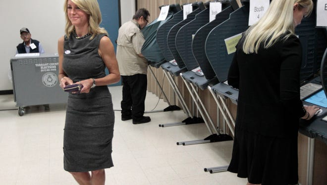 State Sen. Wendy Davis departs after voting at the Southside Community Center in East Fort Worth, Texas, on Oct. 18 during early voting.  Davis had to initial an affidavit swearing to her identity because the name on her driver's license didn't match her voter information.