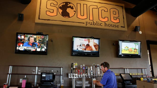 Aaron Felty tests the beer tap at The Source, which is a new restaurant opening in Menasha, located at 890 Lake Park Road on Monday, July 14, 2014.