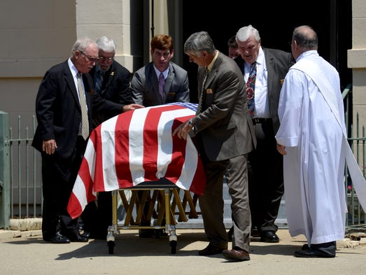 Funeral services for retired Navy Cmdr. Robert Flynn, a prisoner of war for more than five years during the Vietnam War, are held at St. Joseph's Catholic Church on Friday before a procession to Barrancas National Cemetery where he was laid to rest.
