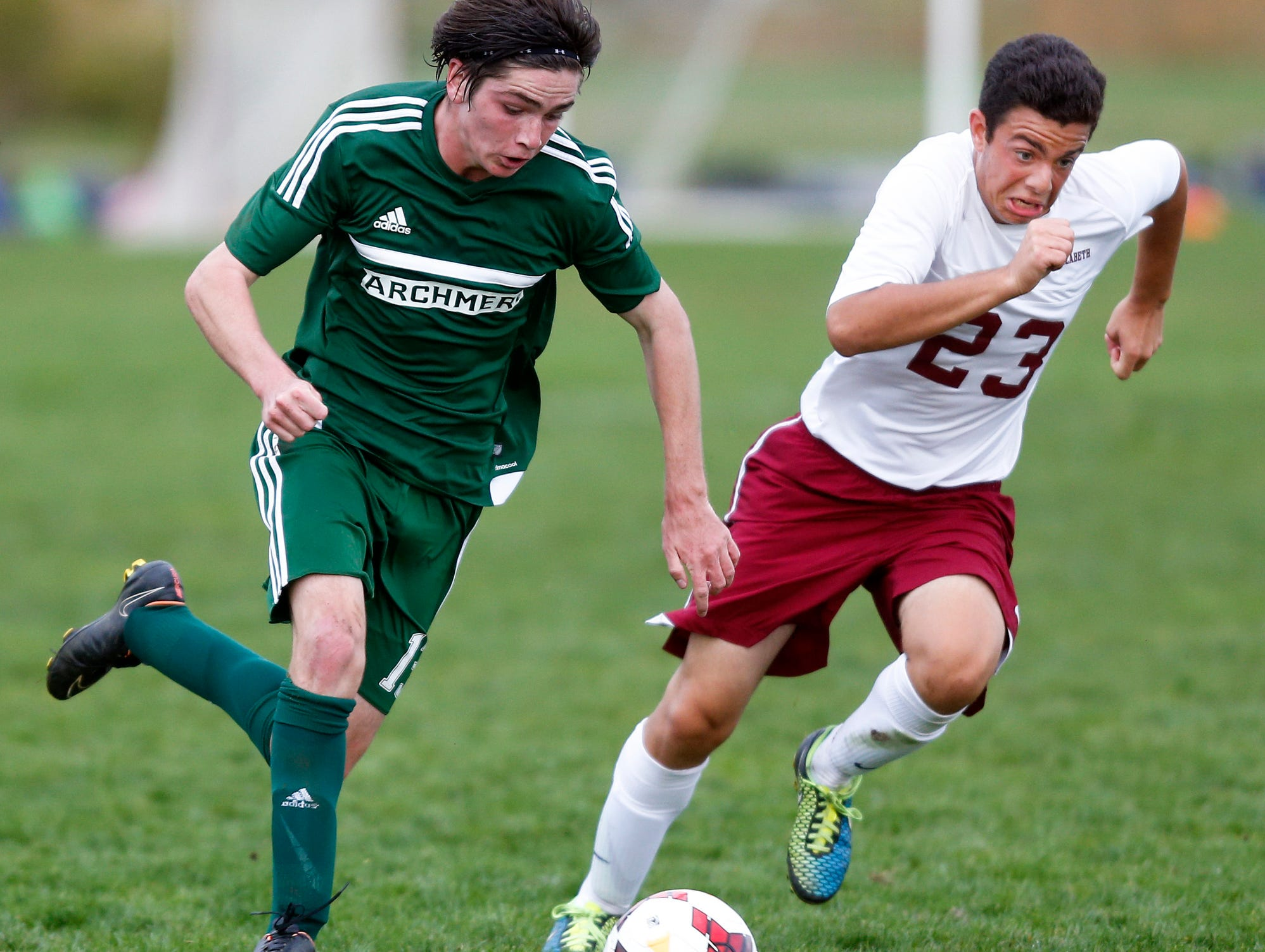Archmere's Matt McCurnin (left) tries to move past St. Elizabeth's Marco Fiasco in the second half of Archmere's 2-1 win at Alapocas Run State Park Tuesday.