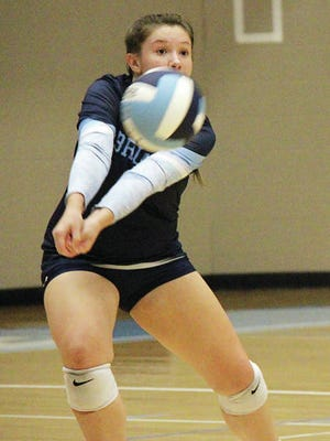 Sydney Collins makes an over-the-head pass for the Bartlesville High School volleyball team. Mike Tupa/Examiner-Enterprise