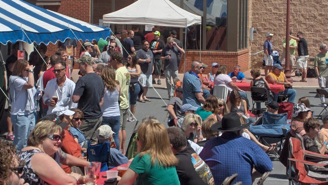 People fill the back lot of Captiol Theatre Center for a past Blues, Brews and BBQ.