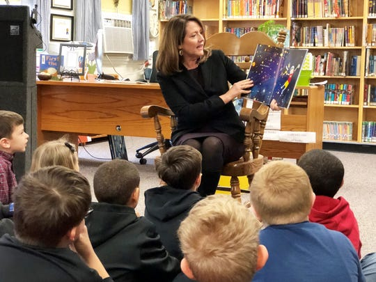 "First lady Crissy Haslam reads ""We're All Wonders"" to third-grade students at Fountain City Elementary."