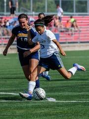 Brookfield Academy junior Anika Washburn (26) takes