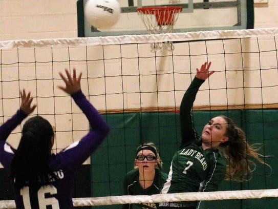 Cloudcroft's Haley Dempsey gets a ball over the net.