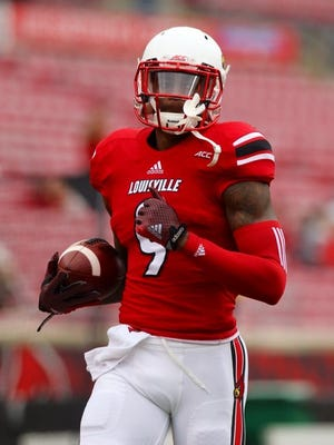 Louisville receiver DeVante Parker warms up with teammates before an Oct. 18 game against North Carolina State. He missed the first seven games of the season.