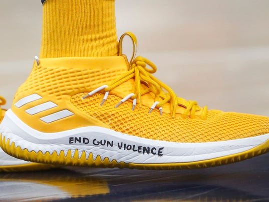 After Florida school shooting, Donovan Mitchell writes a message on his  shoes