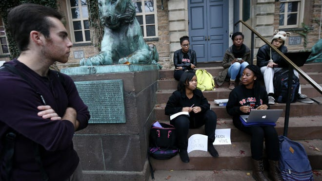 APStudents gather at the entrance of Nassau Hall at Princeton University on Wednesday in Princeton, New Jersey. The students, from a group called the Black Justice League, demand that the school remove the name of former school president and U.S. President Woodrow Wilson from programs and buildings over what they said was his racist legacy. Students gather at the entrance of Nassau Hall at Princeton University, Wednesday, Nov. 18, 2015, in Princeton, N.J. The students, from a group called the Black Justice League, demand that the school remove the name of former school president and U.S. President Woodrow Wilson from programs and buildings over what they said was his racist legacy. (AP Photo/Julio Cortez)