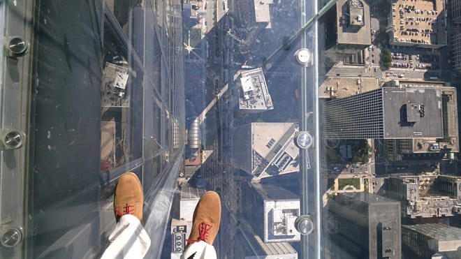The view when looking down from the Skyscape Ledge in Willis Tower.