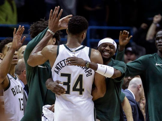 Giannis Antetokounmpo is swarmed by teammates after