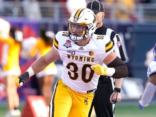 Wyoming linebacker Logan Wilson (30) in the first half during the Arizona Bowl college football game against Georgia State, Tuesday, Dec. 31, 2019, in Tucson, AZ. (AP Photo/Rick Scuteri)