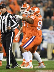 Clemson defensive lineman Dexter Lawrence (90) reacts after a defensive stop against Miami during the 1st quarter of the ACC championship game against Miami at Bank of America Stadium in Charlotte on Saturday, December 2, 2017.