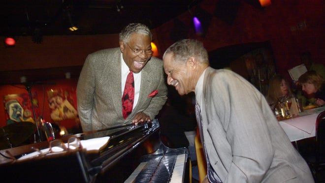 Jazz musician Everett Greene laughs with pianist Marvin Chandler at the Jazz Kitchen in 2002.