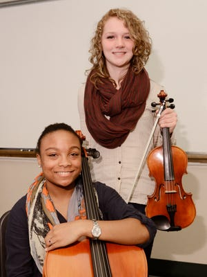 Manitowoc Lincoln High School sophomores Rebekah Lazzeroni, 16, left, and Alyssa Barker, 16, pose for a portrait at the school on Tuesday, Nov. 24. Rebekah and Alyssa will perform at Carnegie Hall in New York City as part of a string orchestra in February.