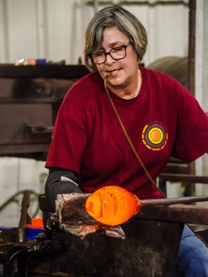 """Patty Manhire blows glass during a previous """"Hot Glass Cold Brew"""" event at First City Art Center. The next event is Friday."""