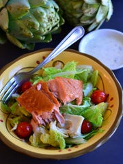 This salad comes together in 10 minutes and includes smoked salmon, artichokes, and tomatoes on a bed of lettuce with a horseradish, dill dressing.