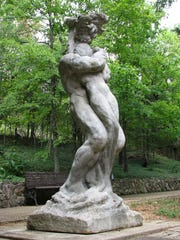"""The Rose O'Neill statue """"Embrace of the Tree"""" stands in front of the rebuilt O'Neill family home at Bonniebrook, north of Branson."""