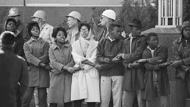 Feb 3, 1965, Selma, Alabama, USA --- Civil rights demonstrators link hands and sing during a protest at the Dallas Country Courthouse in Selma, Alabama. Later, Sheriff Jim Clark ordered deputies to arrest the protesters.