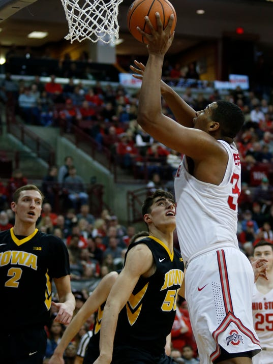 Ohio State forward Kaleb Wesson, right, goes up for a shot against Iowa forward Luka Garza, center, and forward Jack Nunge during the second half of an NCAA college basketball game in Columbus, Ohio, Saturday, Feb. 10, 2018. Ohio State won 82-64. (AP Photo/Paul Vernon)