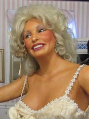 A Dolly Parton look-a-like is one of around 60 wax