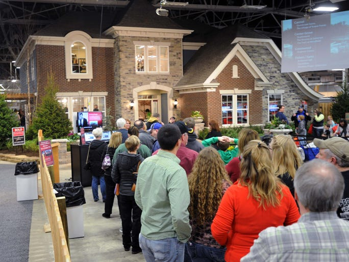 People are lined up waiting their turn to walk through the Fischers Homes centerpiece showhouse. This is a look at the Indianapolis Home Show at the Indiana State Fairgrounds Saturday January 25, 2014.